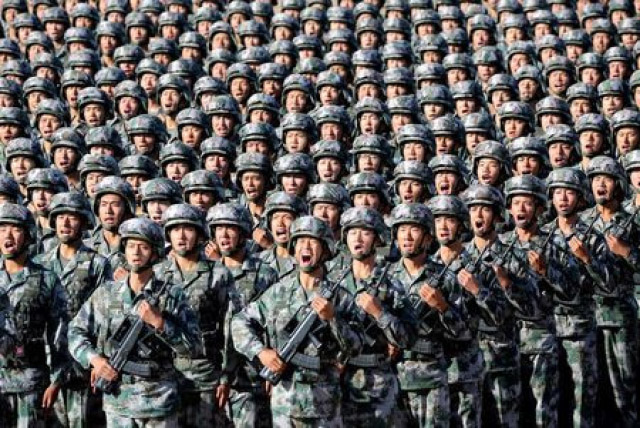 China Defends Hike in Military  Spending As Proportionate and Low